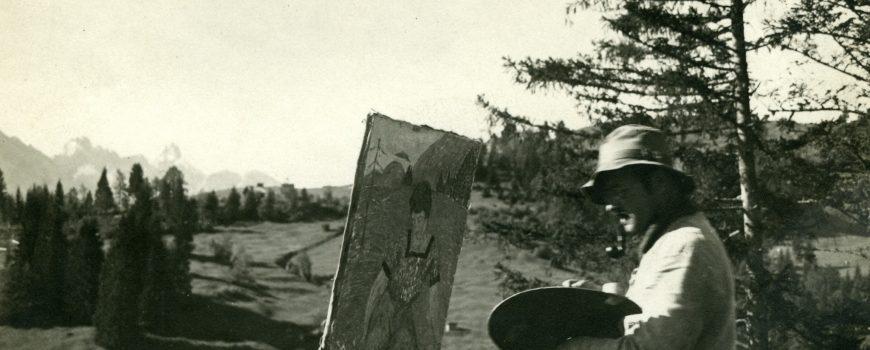 Egon Hofmann malend mit Palette und Hut im Freien