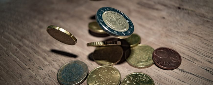 close-up-of-coins-on-table-332304